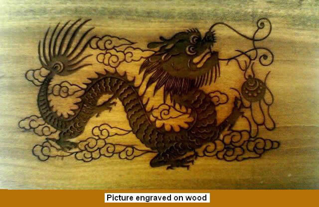 CO2 Laser Marked Wood With Intricate Dragon Design And Attractive Charred Look