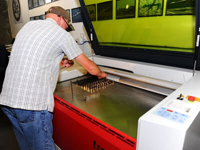 John Daniels Shop Technician Pre-checks Setup for Laser Engraving